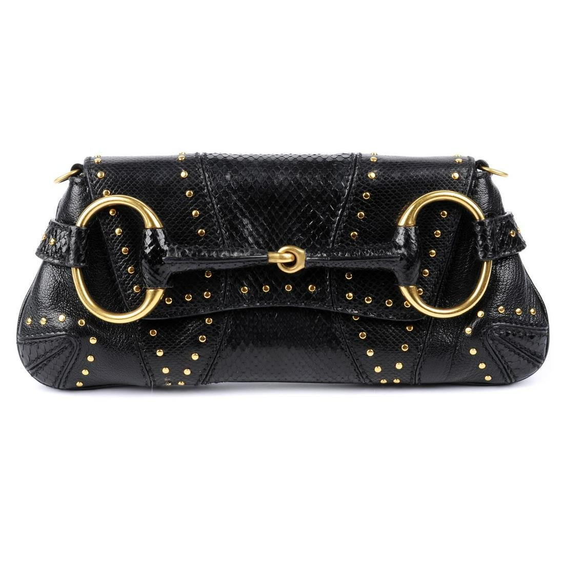 GUCCI - a black Horsebit clutch. Crafted from black