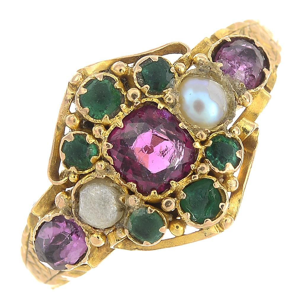 A late Victorian 18ct gold gem-set ring.Gems to include