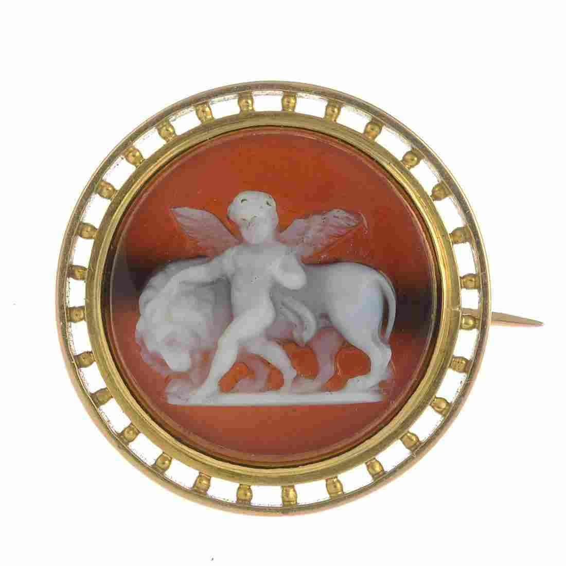 A late Victorian gold hardstone cameo brooch.Diameter
