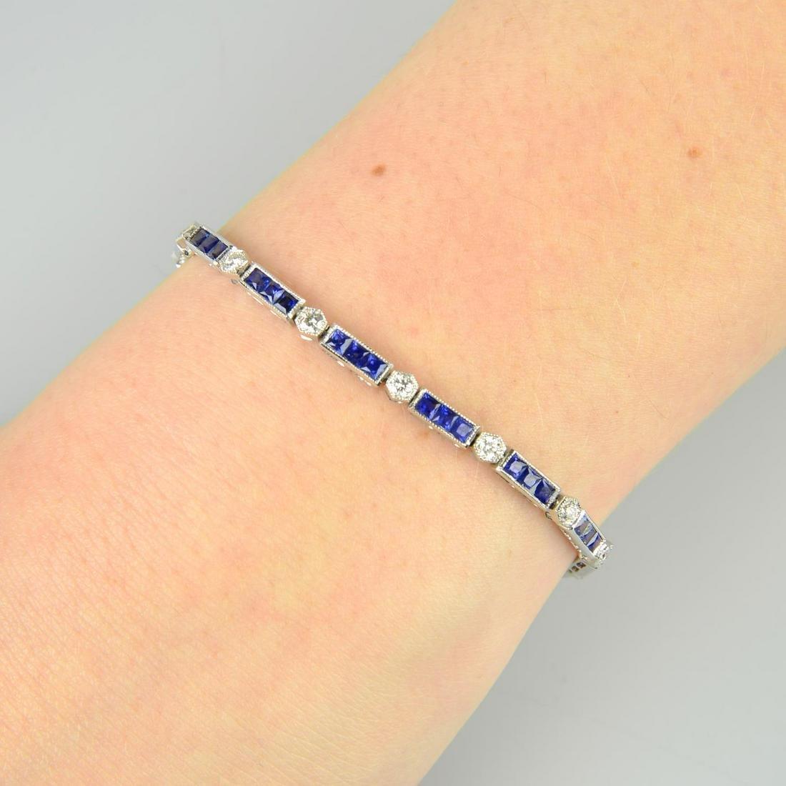 An 18ct gold sapphire line bracelet, with brilliant-cut