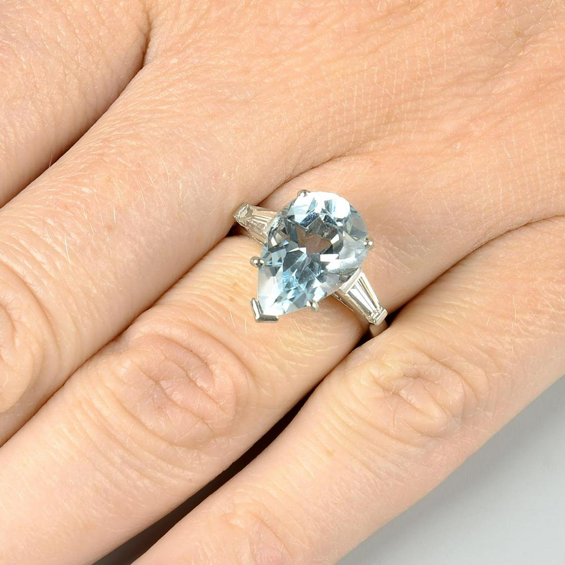 A platinum aquamarine single-stone ring, with tapered