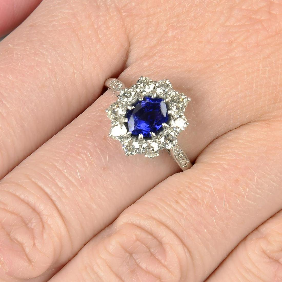 A Burmese sapphire and old-cut diamond cluster ring,