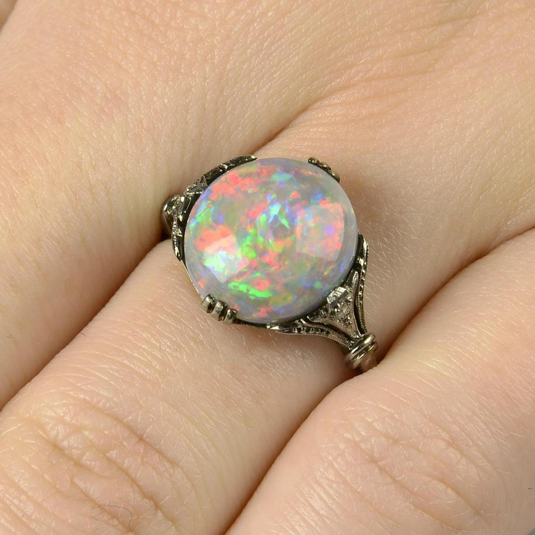 A black opal and rose-cut diamond accent ring.Opal