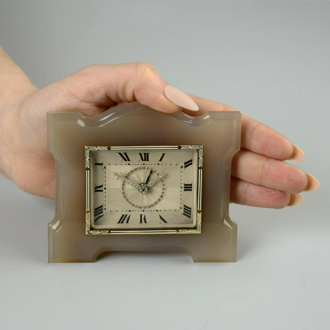 An Art Deco agate French desk clock, with diamond