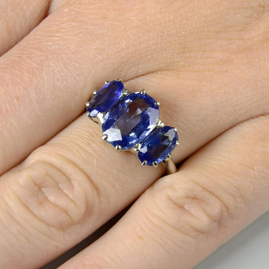 A graduated oval-shape Sri Lankan sapphire three-stone