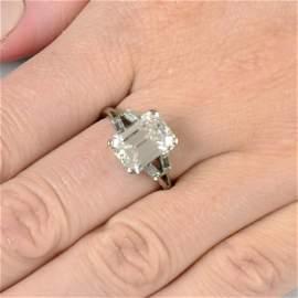 A cut-corner rectangular-shape diamond single-stone