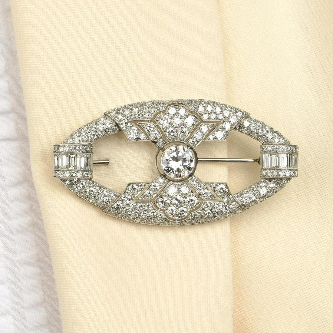 An Art Deco platinum diamond brooch.Principal diamond