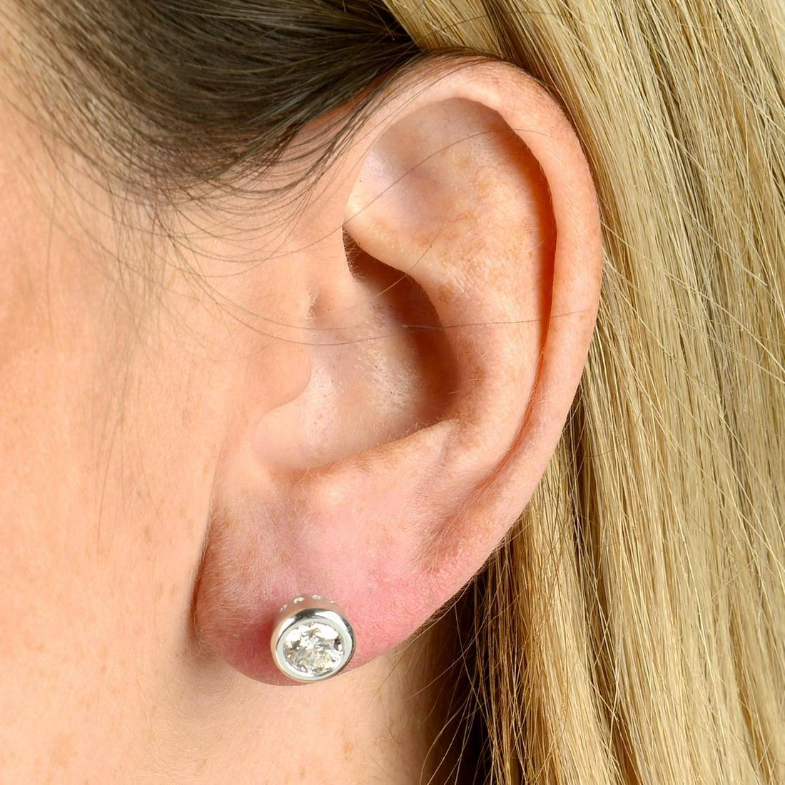 A pair of brilliant-cut diamond collet stud