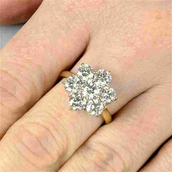An 18ct gold brilliant-cut diamond floral cluster ring.