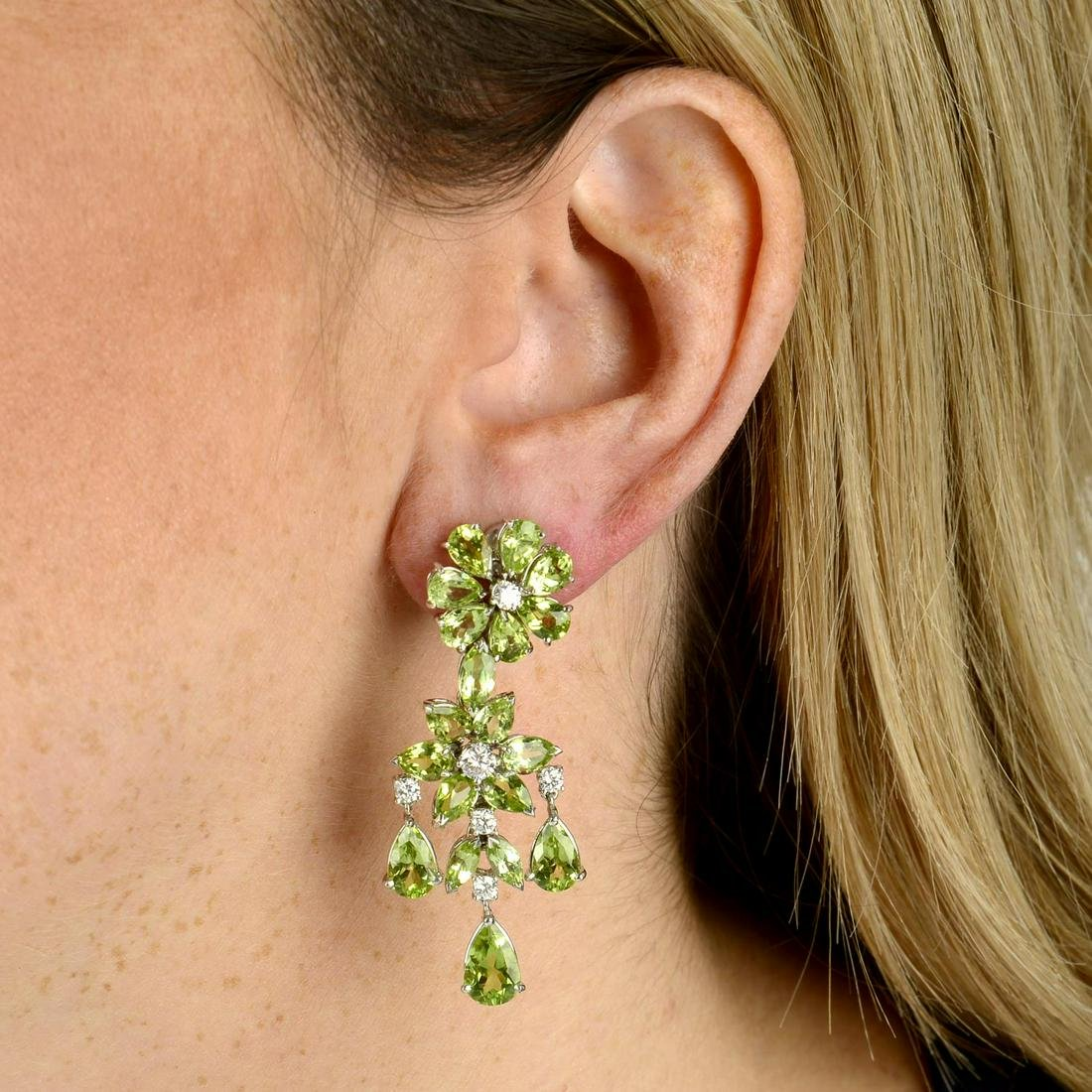 A pair of 18ct gold peridot and diamond floral cluster
