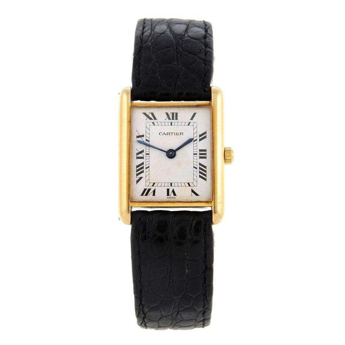 CARTIER - a Tank wrist watch. Yellow metal case,
