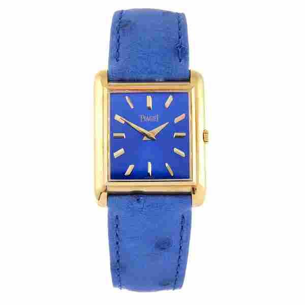 PIAGET - a lady's wrist watch. Yellow metal case,