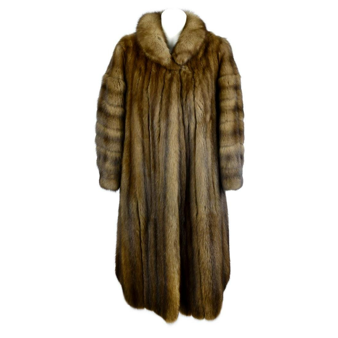 A full length sable fur coat. Designed with a short