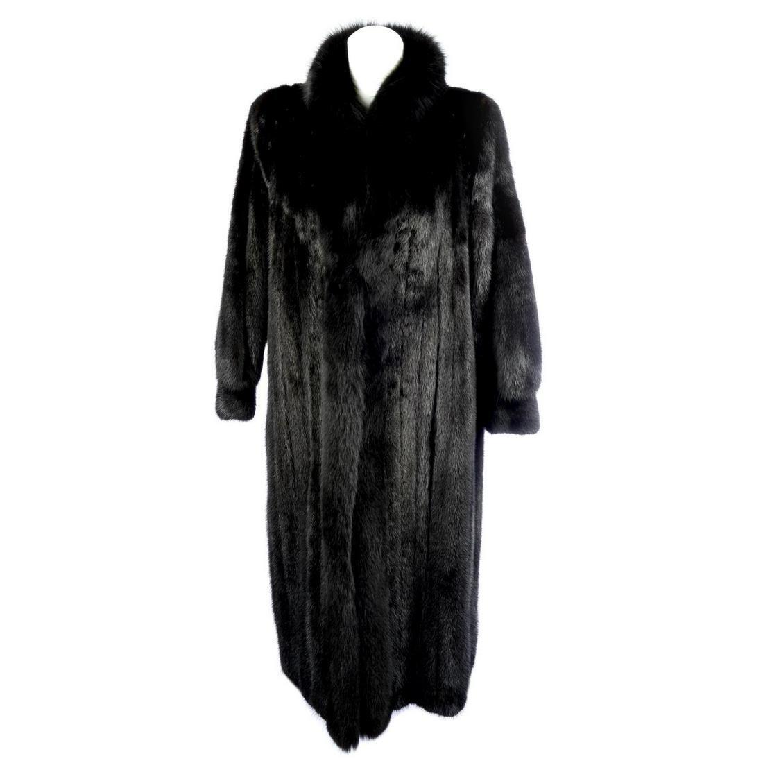 A full length black mink coat with fox fur trim.