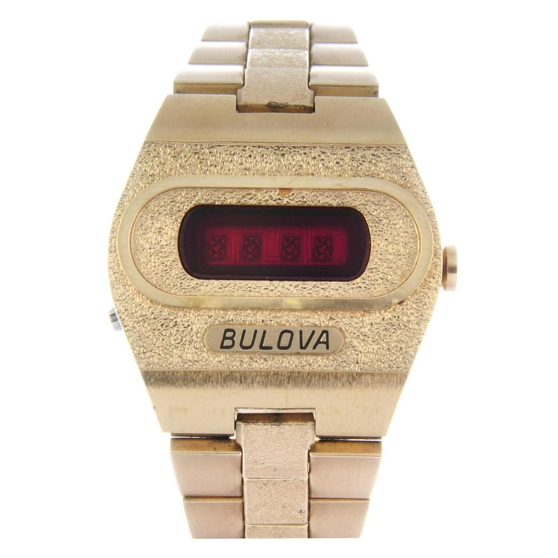 BULOVA - a gentleman's Accuquartz bracelet watch. Gold