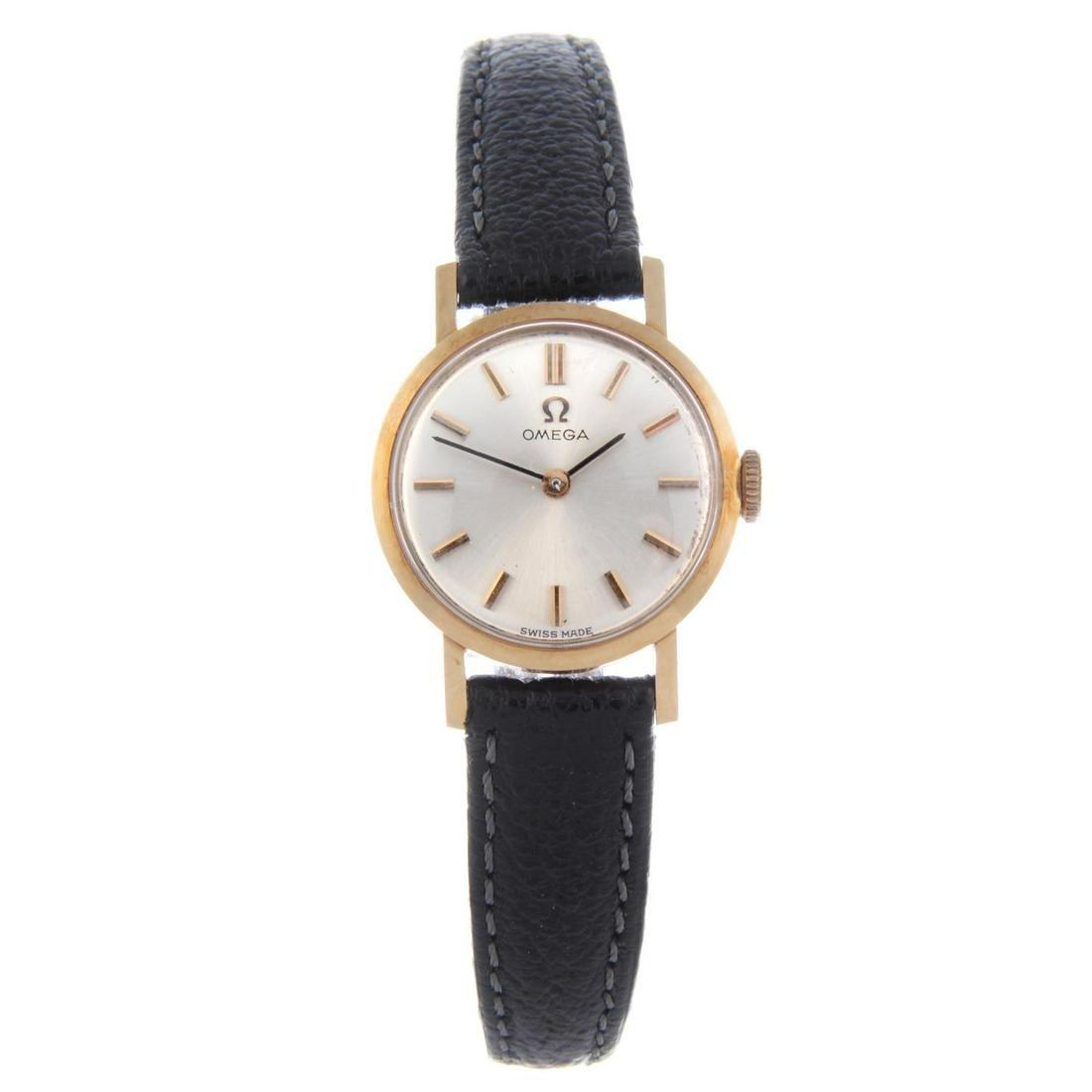 OMEGA - a lady's wrist watch. Yellow metal case,
