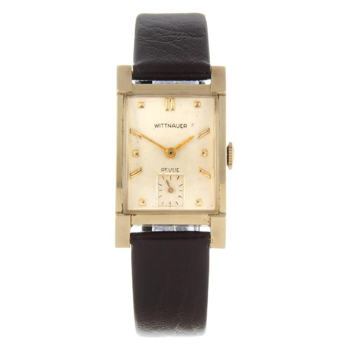 WITTNAUER - a Revue wrist watch. Yellow metal case,