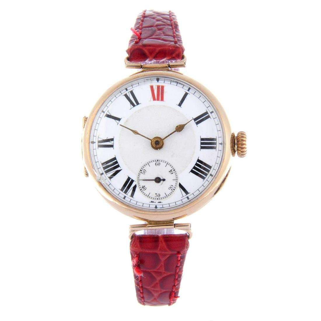 A trench style wrist watch. 9ct yellow gold case with