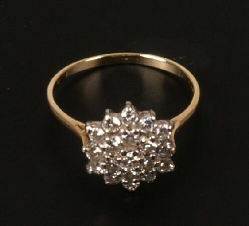 12: 18ct gold all diamond three tiered cluster ring.