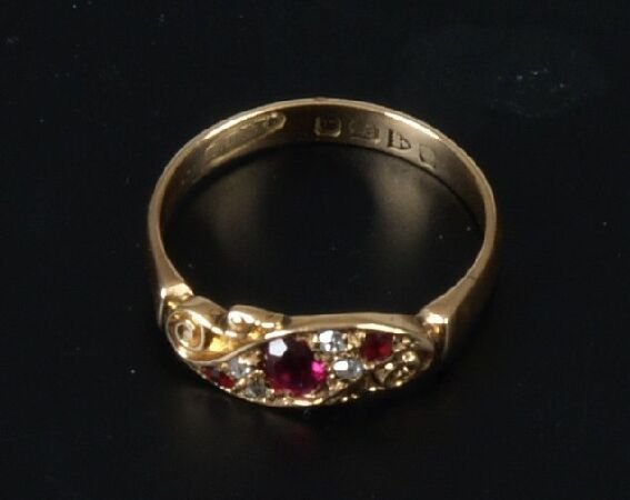 16: Early 20th century ruby and diamond five stone cros
