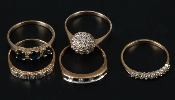 18: Five gold mounted diamond set rings to include two