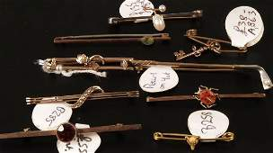 728 A collection of bar brooches to include a 15ct go