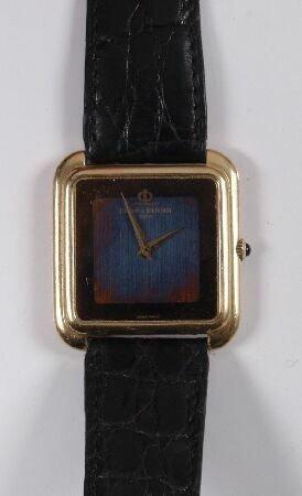 1003: BAUME & MERCIER -  a gentleman's 18ct gold square