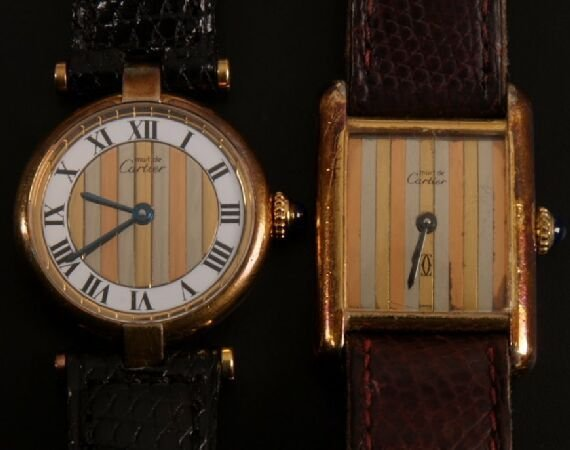 1014: CARTIER - a ladies gold plate on silver round wat