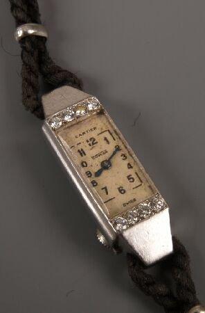 1015: CARTIER - Duoplan platinum cocktail watch with ta