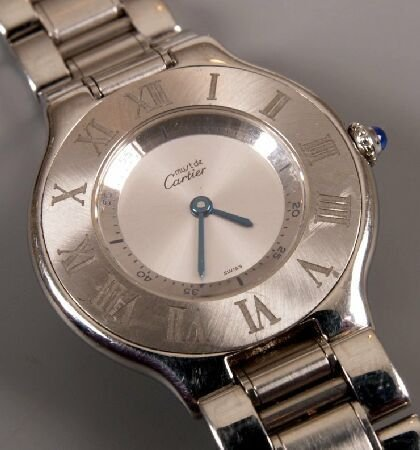 1016: CARTIER - gentleman's steel Must 21 on a bracelet