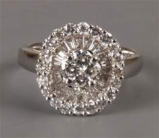 18ct white gold diamond dress ring with a central cl