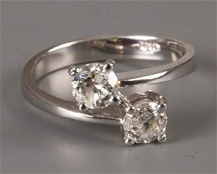 18ct white gold diamond two stone crossover ring of