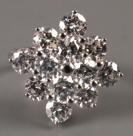 11: 18ct white gold twelve stone diamond cluster ring o
