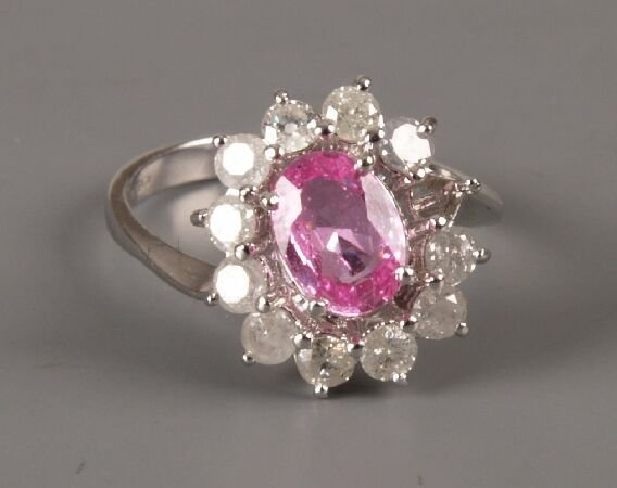 17: 18ct white gold oval pink sapphire and diamond elev
