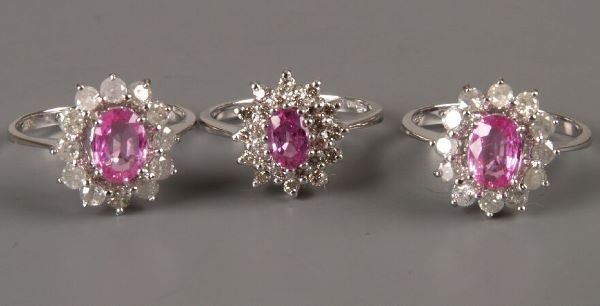 21: Two 18ct white gold oval pink sapphire and diamond