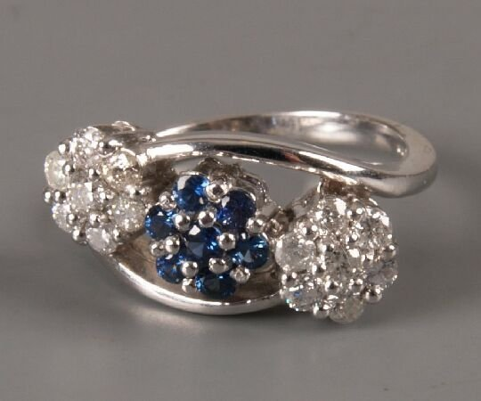 22: 18ct white gold triple cluster ring with a central