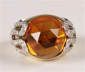 195: VERSACE - 18ct gold dress ring with central caboch