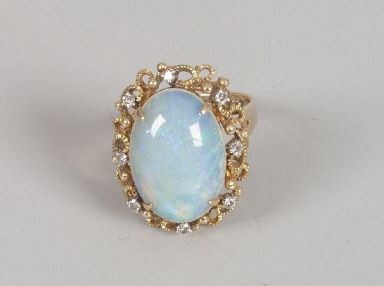 1001: Large oval opal 13mm x 19mm within a di