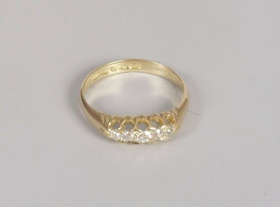 1004: 18ct gold five stone old cut diamond ha