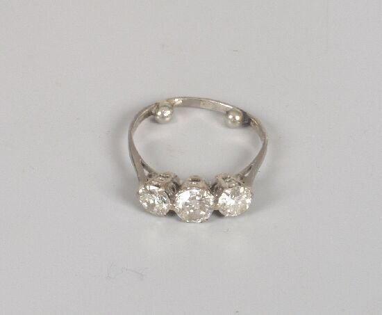 1012: Three stone claw set diamond ring with