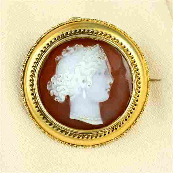 A late Victorian gold sardonyx cameo brooch, carved to