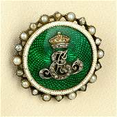 An early 20th century silver and gold enamel brooch and