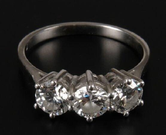 1: Platinum mounted three stone round brilliant diamond