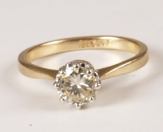 15: 18ct gold claw set single stone diamond ring of app