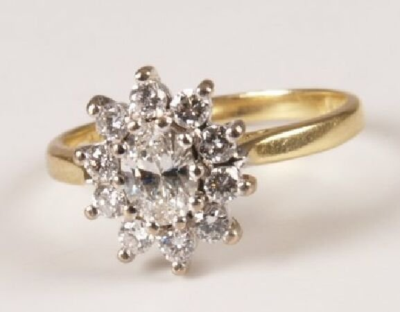 16: 18ct gold diamond eleven stone cluster ring with a