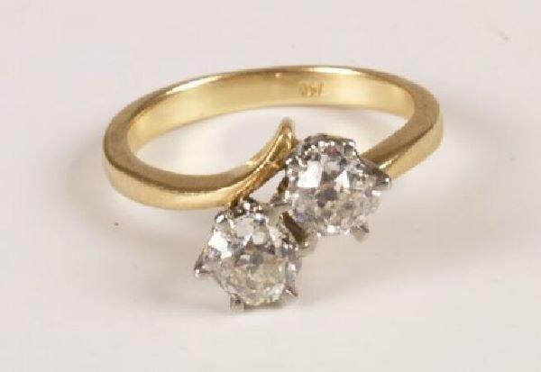 22: 18ct gold two stone old European cut diamond cross