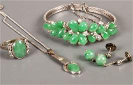 440: Jade and diamond set suite comprising an 18ct whit