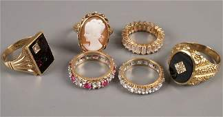 599 A small collection of six dress rings to include