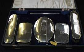 933: A gentleman's silver cased brush and mirror set co