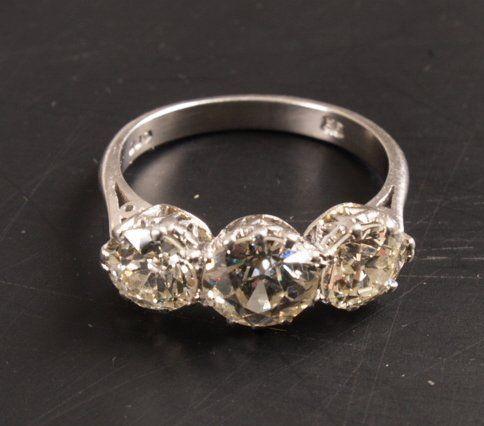 Platinum mounted three stone old cut diamond ring w